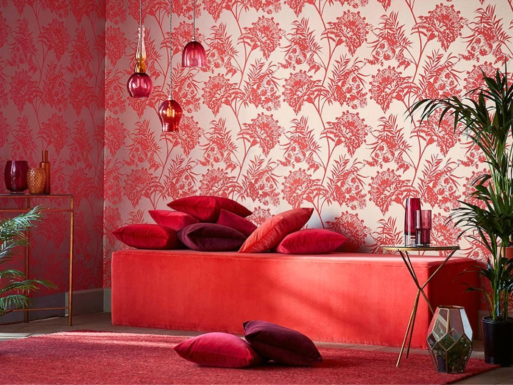 The impact of red wallpaper in a room is to make the room appear as smaller and hotter.
