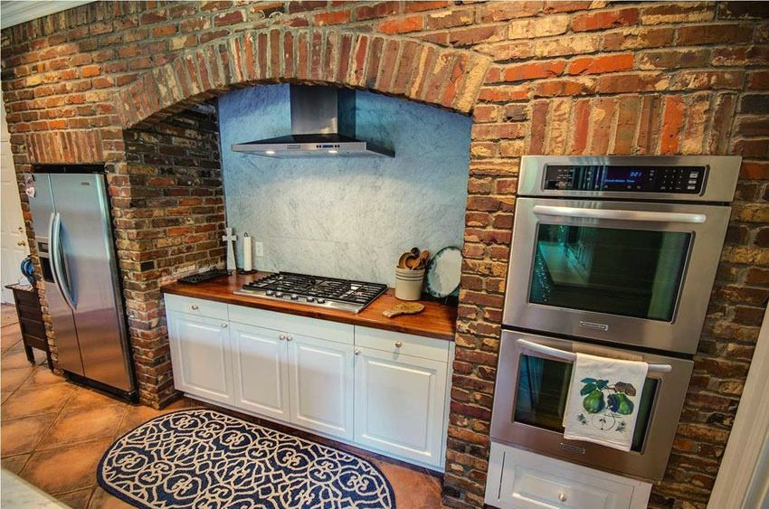 Using stylish sidewalls over the stove add traditional design to your dream kitchen.